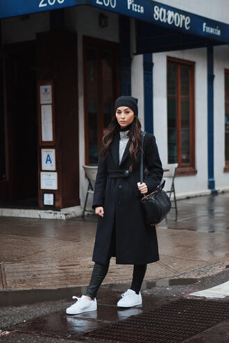 caradisclothed blogger hat shoulder bag black bag black coat grey sweater white sneakers winter outfits