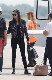 jeans,irina shayk,jacket,bag,boots,shoes,sunglasses,all black everything,airport fashion,givenchy bag,versace,saint laurent