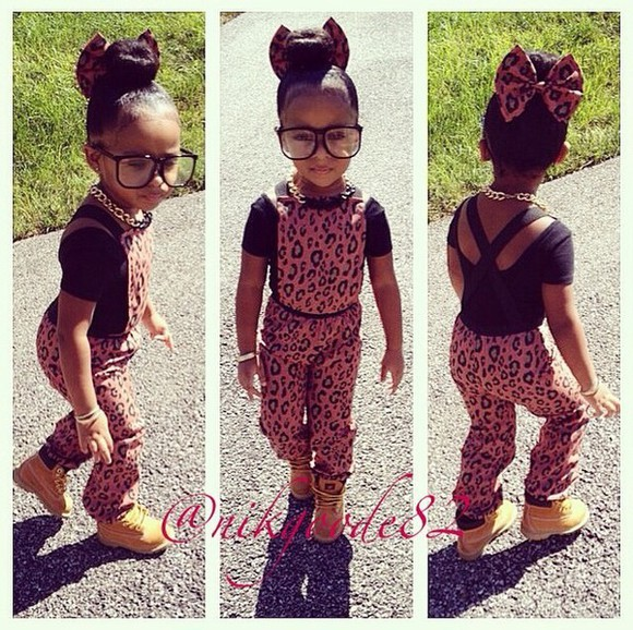 girl kids fashion girly bows hair bow leopard print jumpsuit fashion gold chain gold chain necklace jumper overalls Glasses timberlands Gold black chain hair bun criss cross strap low back shirt leopard print jumpsuit Leopard print bow joggers Jogger jumper