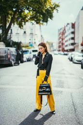 not jess fashion,blogger,top,pants,bag,jewels,fall outfits,yellow pants,black blouse,black bag,tumblr,wide-leg pants,yellow,shirt,black shirt,black boots,handbag