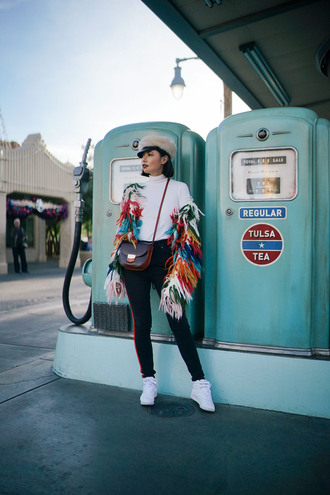 olivia lazuardy blogger hat top bag shoes crossbody bag cap winter outfits multicolor jacket