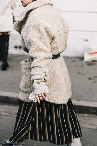 coat tumblr fashion week 2017 streetstyle teddy bear coat white fluffy coat fuzzy coat belt skirt stripes striped skirt maxi skirt oversized ring gold ring jewels jewelry white oversized coat