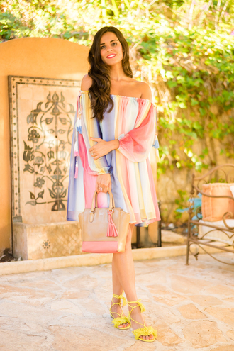 crimenes de la moda blogger dress shoes bag rainbow yellow puffed sleeves multicolor mini dress short dress long sleeves off the shoulder off the shoulder dress brown bag handbag fringe shoes sandals flat sandals yellow sandals date outfit summer dress summer outfits