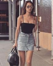 shirt,tank top,black,top,sleeveless,sleeveless top,celebrity style,skirt,black tank top,distressed denim skirt,blogger,sunglasses,black bag