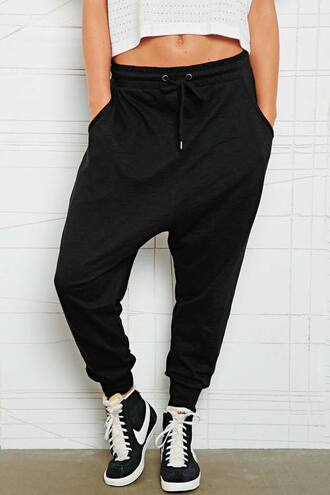 black sweatpants sweatpants sportswear nike sneakers high top sneakers white crop tops harem pants