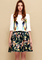 White half sleeve embroidered top with black floral skirt