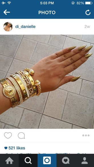 jewels gold pointy nails stiletto nails gold ring gold watch love bracelet gold bracelet