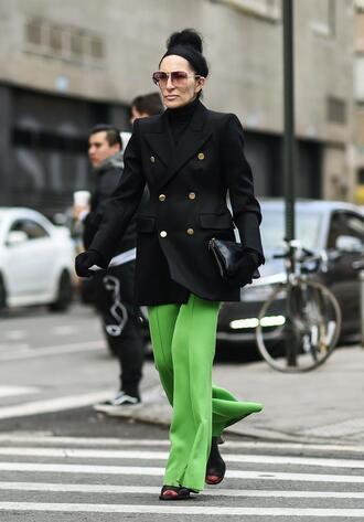 pants nyfw 2017 fashion week 2017 fashion week streetstyle green pants blazer black blazer turtleneck black turtleneck top black top mules shoes black shoes sunglasses bag black bag gloves