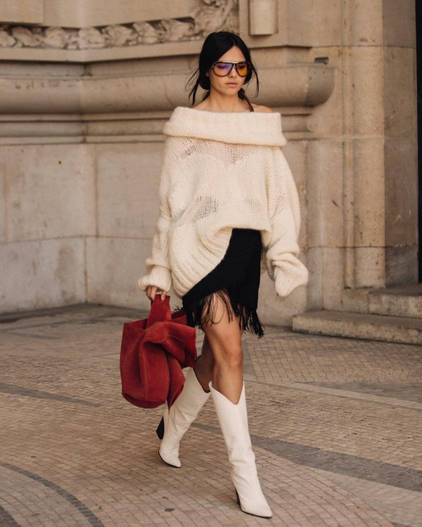skirt tassel midi skirt white boots cowboy boots handbag oversized sweater off the shoulder sunglasses