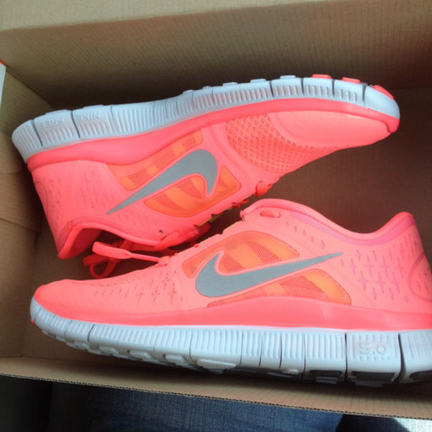 coral color nike shoes