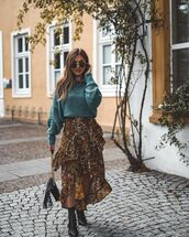 dress,asymmetrical dress,ruffle dress,floral dress,printed dress,ankle boots,black boots,shoulder bag,belt,sweater,knitted sweater,sunglasses