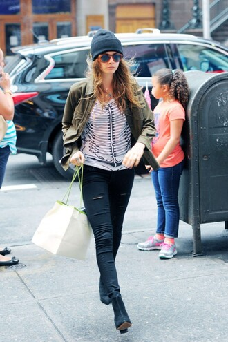 top cara delevingne pants jeans ripped jeans jacket beanie sunglasses