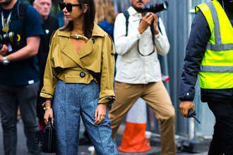 jacket mustard jacket fashion week street style fashion week 2016 fashion week london fashion week 2016 cropped jacket necklace statement necklace pants blue pants printed pants high waisted pants bag black bag sunglasses tortoise shell tortoise shell sunglasses fall outfits streetstyle