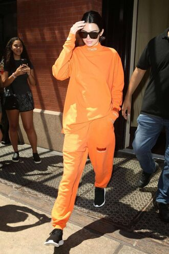 sweater sweatshirt sweatpants orange kendall jenner kardashians sneakers sunglasses streetstyle model off-duty sportswear pants