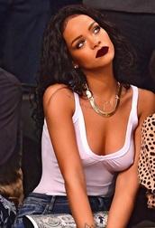make-up,jeans,shirt,rihanna,lipstick,rihanna style,bag,jewels,top,white,black,tank top,tan,braless,braless babe,red,red lipstick,denim,celebrity style,celebrities in white,celebstyle for less