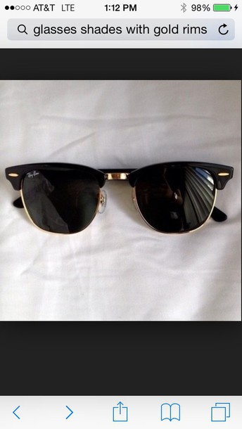 sunglasses black with gold rims .