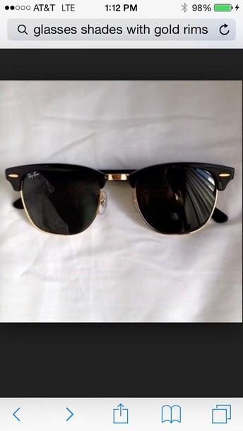 sunglasses black with gold rims .