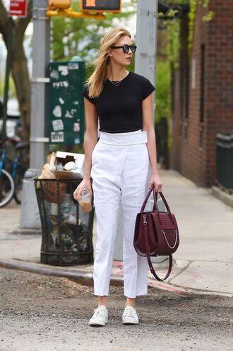shoes black t-shirt ehite flare pants burgundy bag sunglasses white sneakers
