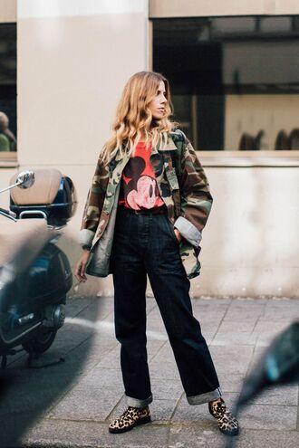 jacket fashion week street style fashion week 2016 fashion week paris fashion week 2016 camouflage t-shirt graphic tee denim jeans blue jeans cuffed jeans shoes streetstyle flats leopard print