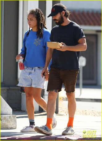 top sasha lane celebrity style celebrity actress shia labeouf actor mens t-shirt menswear mens shorts mens sneakers sneakers white sneakers socks sweatshirt blue top denim shorts denim shorts blue shorts hairstyles
