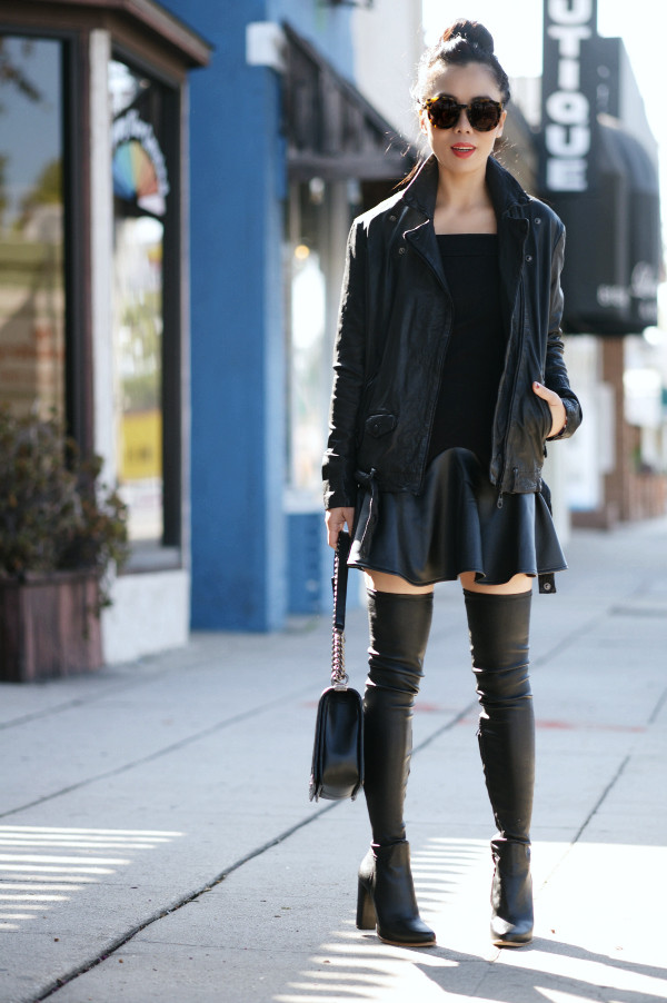 hallie daily blogger jacket bag sunglasses jewels ruffle thigh high boots