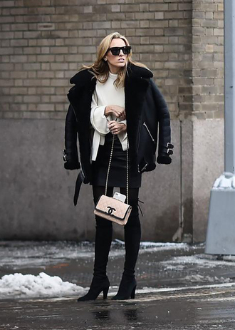 jacket nyfw 2017 fashion week 2017 fashion week streetstyle black jacket black leather jacket leather jacket shearling jacket black shearling jacket sweater white sweater skirt mini skirt black skirt black leather skirt leather skirt bag nude bag chanel chanel bag tights opaque tights boots black boots high heels boots sunglasses