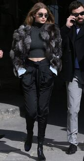 crop tops,turtleneck,fashion week 2016,paris fashion week 2016,fur,gigi hadid,model off-duty,sunglasses,black pants,round sunglasses,black boots,all black everything,topshop