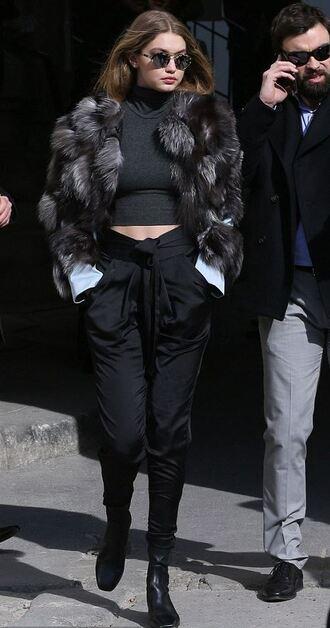crop tops turtleneck fashion week 2016 paris fashion week 2016 fur gigi hadid model off-duty sunglasses black pants round sunglasses black boots all black everything topshop