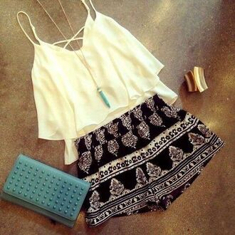 printed shorts white top summer top beach gemstone leather pouch gold bracelet cuff bracelet black and white shorts shorts top ruffle criss cross back summer outfits cute outfits outfit spring outfits turquoise pendant