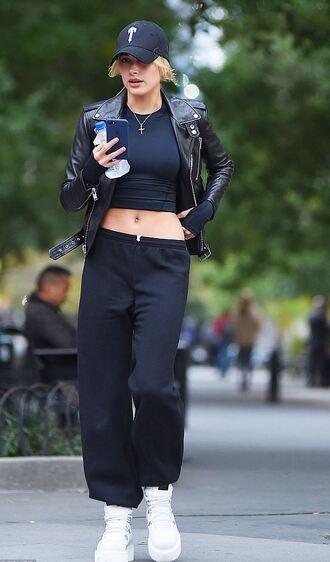 shoes sneakers hailey baldwin cap crop tops jacket biker jacket model off-duty streetstyle sweatpants hat black baseball hat