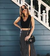 top,reformation,black crop top,crop tops,black top,skirt,slit skirt,stripes,striped skirt,bag,black bag,accent earrings,sunglasses