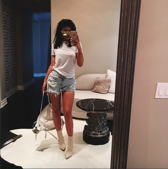 shorts fashion style kylie jenner white top t-shirt white t-shirt short denim denim shorts ripped shorts purse bag sunglasses shoes celebrity style celebrity nude boots white bag mirrored sunglasses summer outfits high waisted ankle boots cream ripped outfit