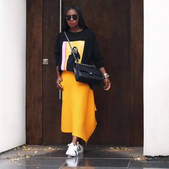skirt black sweater tumblr midi skirt yellow yellow skirt asymmetrical asymmetrical skirt sneakers white sneakers low top sneakers sweater bag black bag sunglasses