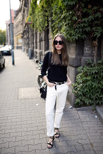 le fashion image blogger sweater jeans shoes white jeans belt black belt black top black sweater long sleeves black sunglasses black bag shoulder bag sandals flat sandals black sandals