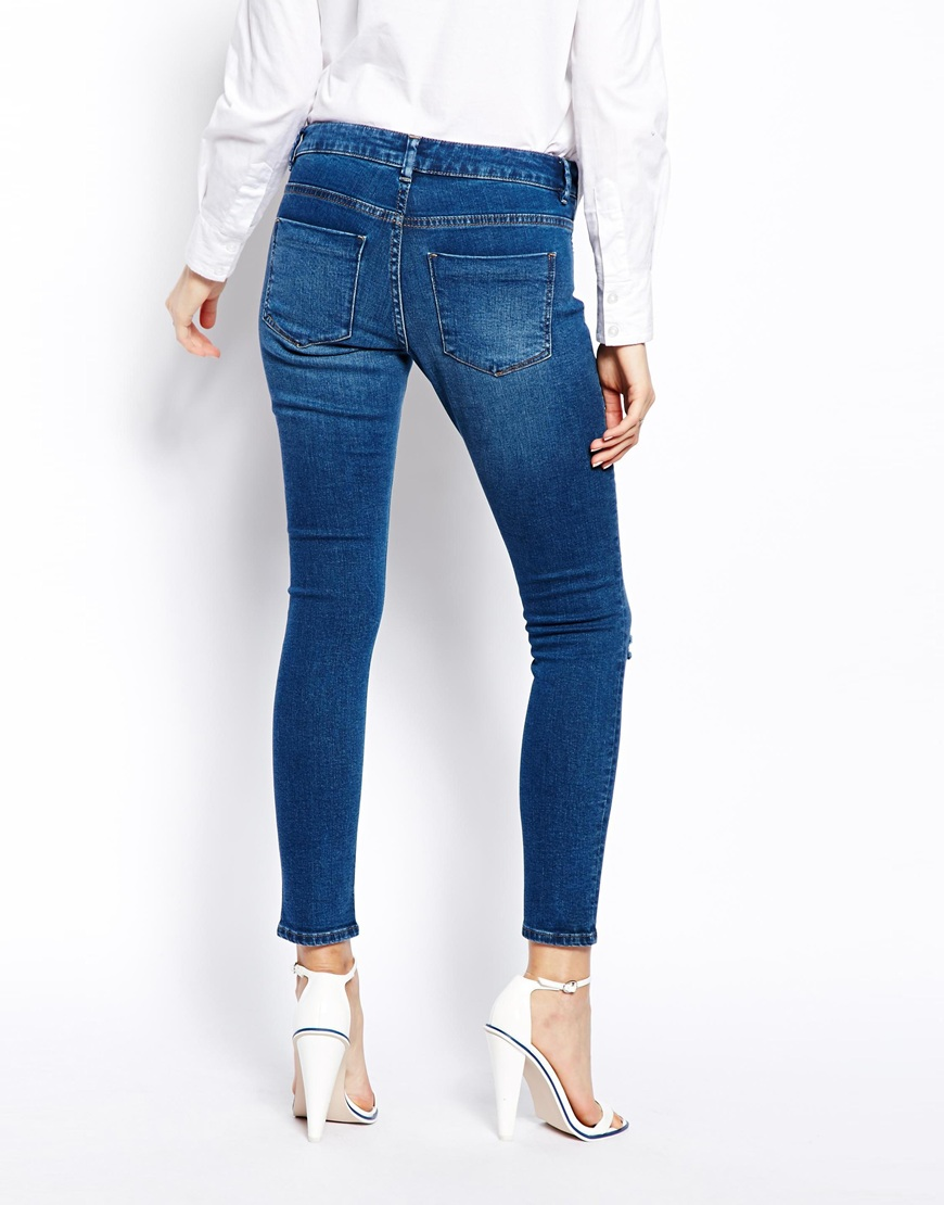 ASOS Whitby Low Rise Skinny Ankle Grazer Jeans in Faded Authentic Dark Wash Blue with Ripped Knees at asos.com