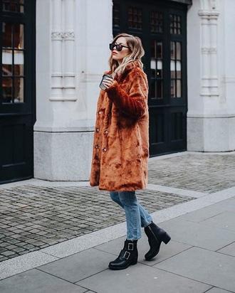 coat rust fur coat black boots sunglasses blue jeans denim jeans boots