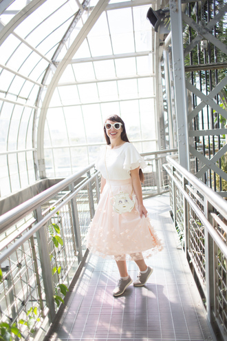 kelsey bang blogger shirt shorts shoes skirt sunglasses make-up bag midi skirt white top sneakers pink skirt