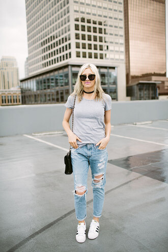 little miss fearless blogger t-shirt jeans shoes bag sunglasses make-up ripped jeans grey t-shirt white sneakers sneakers adidas