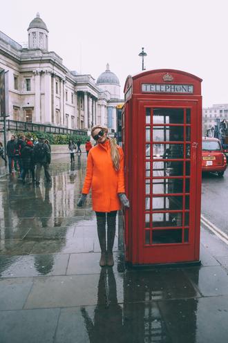 barefoot blonde blogger coat sunglasses winter coat orange