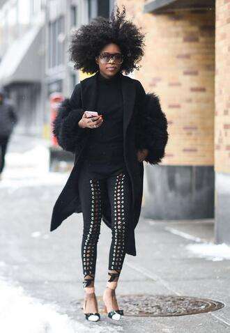 coat nyfw 2017 fashion week 2017 fashion week streetstyle leggings black leggings lace up shoes ankle strap heels ankle strap sweater black sweater black coat curly hair hairstyles all black everything