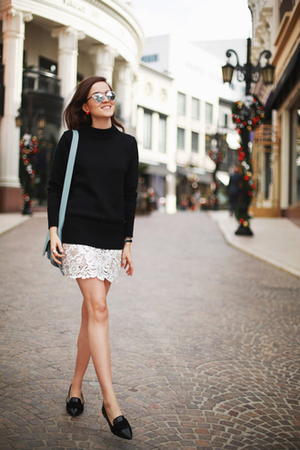 blogger sweater lace skirt loafers mirrored sunglasses black loafers black sweater sweater over dress white dress mini dress thanksgiving outfit