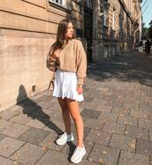 skirt,mini skirt,wrap ruffle skirt,white skirt,sneakers,white sneakers,sweater,knitted sweater,oversized sweater,shoulder bag