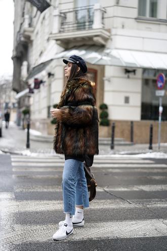 jacket socks tumblr fur jacket brown brown jacket denim jeans blue jeans cropped jeans nike nike shoes sneakers white sneakers low top sneakers hat fisherman cap black hat