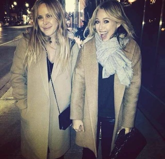 coat hillary duff camel coat winter outfits winter coat tan coat scarf gray gray scarf black bag bag