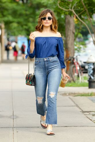 blouse off the shoulder sophia bush jeans purse sunglasses