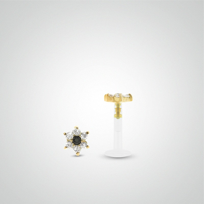 18 carats yellow gold flower tragus piercing.