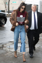 jeans,top,streetstyle,ny fashion week 2017,kendall jenner,kardashians,sunglasses,choker necklace,nyfw 2017,shirt,louis vuitton,graphic tee,kendall and kylie jenner,kendall and kylie,lv,maroon shirt