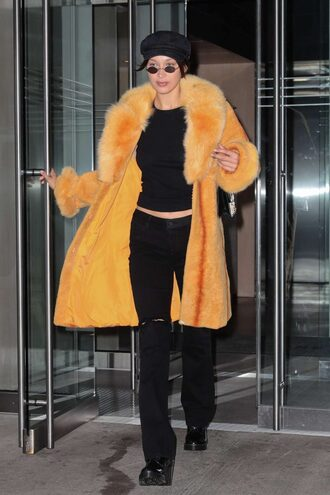 jeans top fur orange bella hadid streetstyle model off-duty hat black hat accessories accessory model newsboy hat cabby hat
