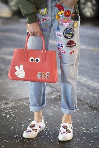 bag patch orange bag jeans blue jeans patched denim slip on shoes white shoes patched jeans boyfriend jeans blogger streetstyle fashion week embellished denim