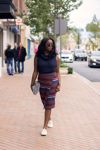 millennielle blogger skirt sweater bag furry pouch sleeveless turtleneck sweater turtleneck wrap skirt striped skirt stripes asymmetrical asymmetrical skirt midi skirt sneakers white sneakers aviator sunglasses low top sneakers